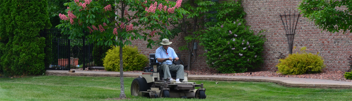 mowing lawn in St. Clair